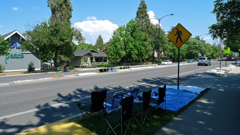 putting out the blankets chairs tarps for ashland oregon fourth of july parade