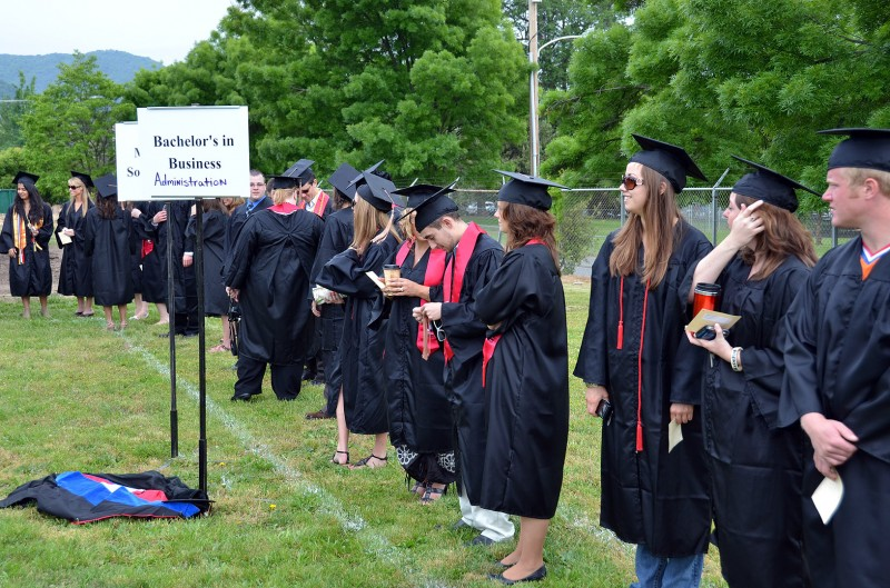 school of business students line up for graduation