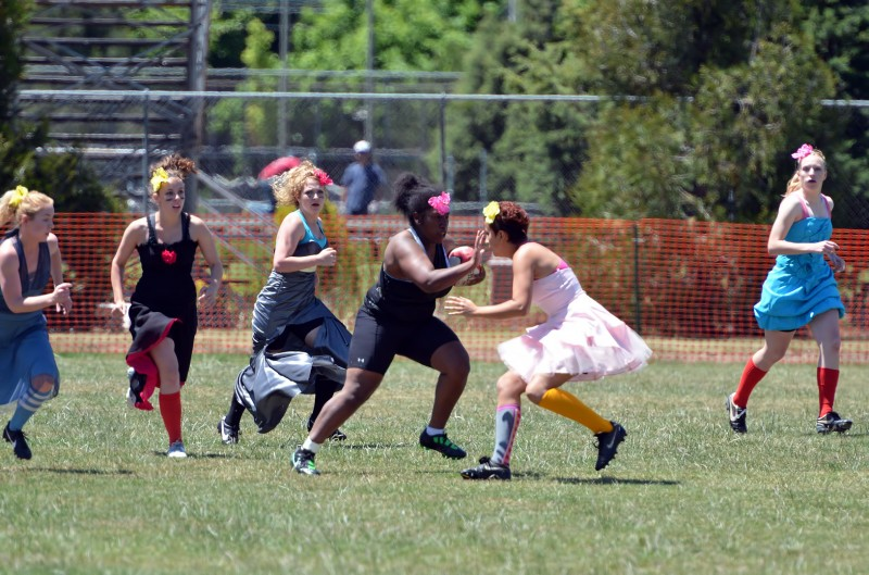 stiff arm female rugby football
