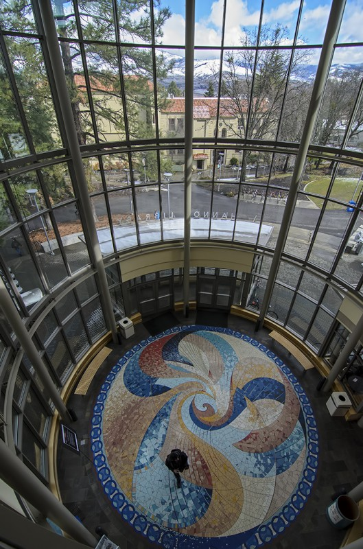 Robert Stout and Stephanie Jurs created the spectacular 28-foot ceramic mosaic that adorns the floor of the entrance rotunda hannon library sou
