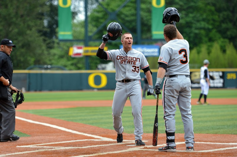 ryan barnes osu baseball homerun helmet high five Kavin Keyes