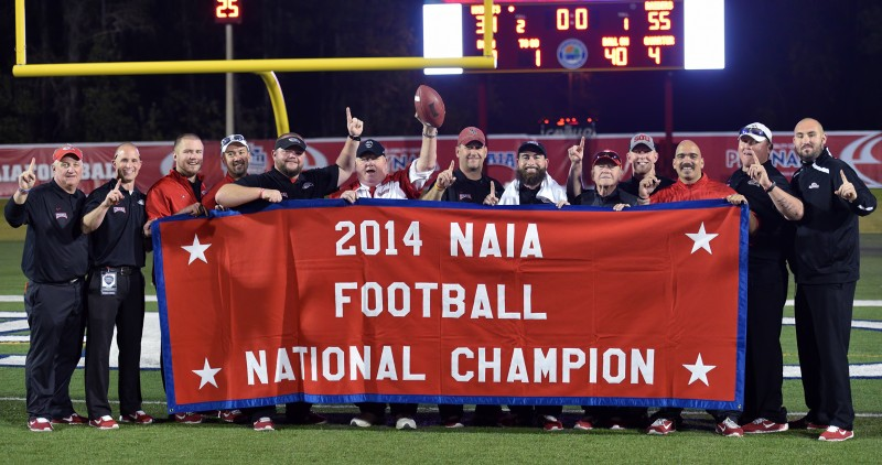SOU football coaching staff national champion banner 2014 naia