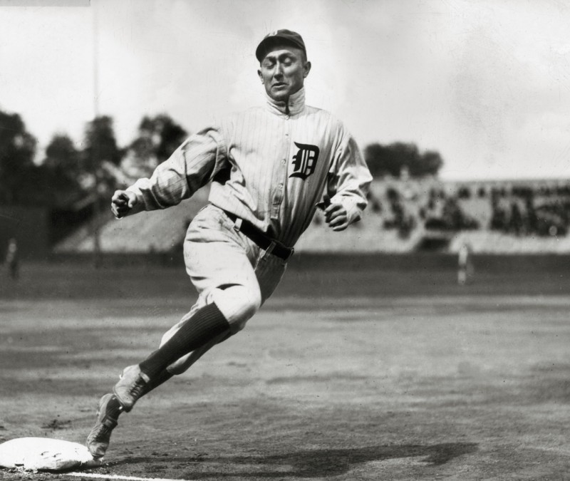 circa 1915:  Full-length image of Detroit outfielder Ty Cobb (1886 - 1961) touching third base while running during a baseball game.  (Photo by Hulton Archive/Getty Images)