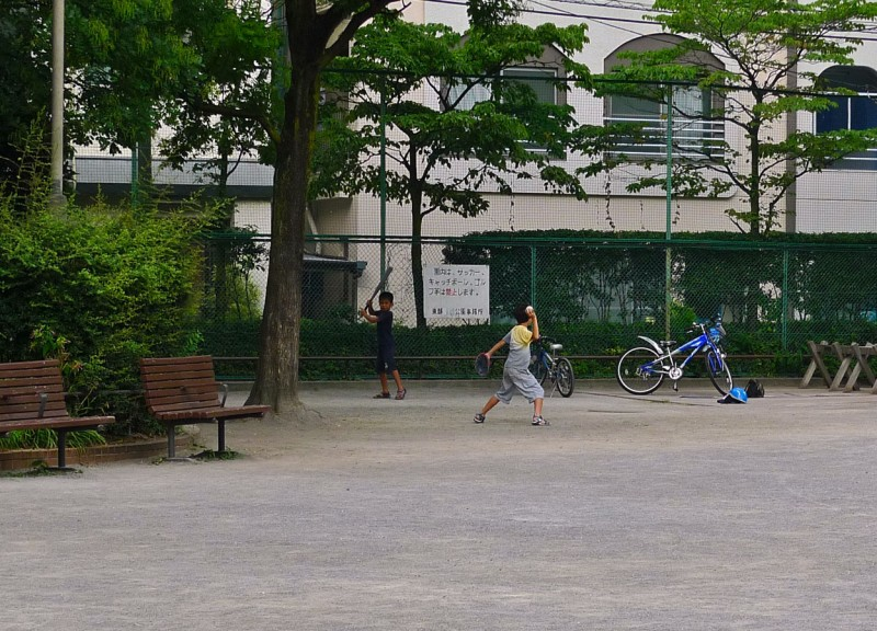 japanese kids playing baseball in the park