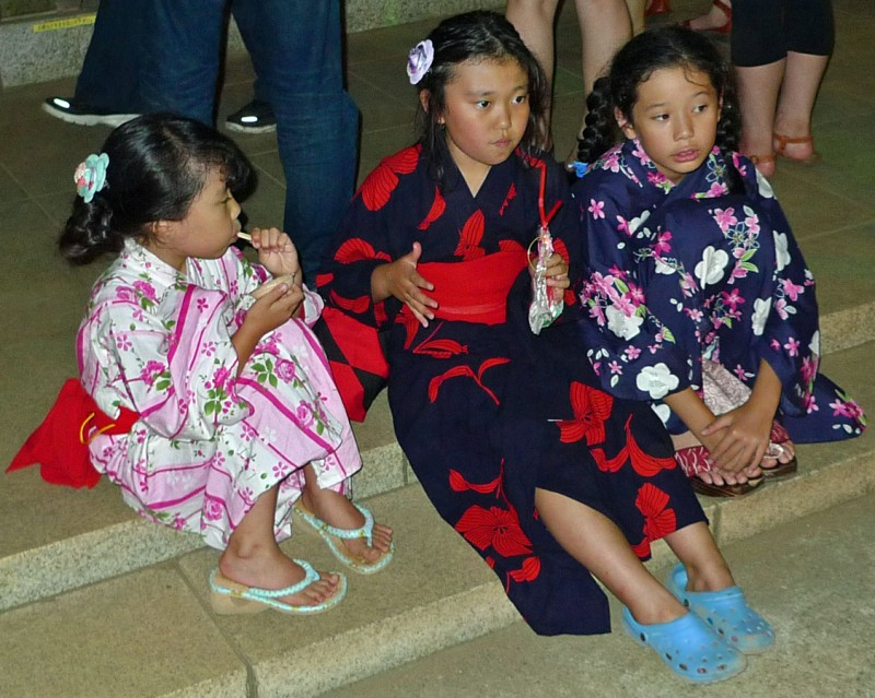 japanese girls enjoying summer festival dressed in kimono yukata