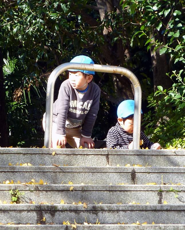 japanese kindergarteners playing hide and go seek near waseda university tokyo japan