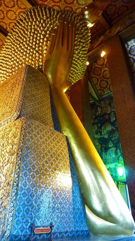 buddha rests on hand and two giant gold blocks bangkok thailand