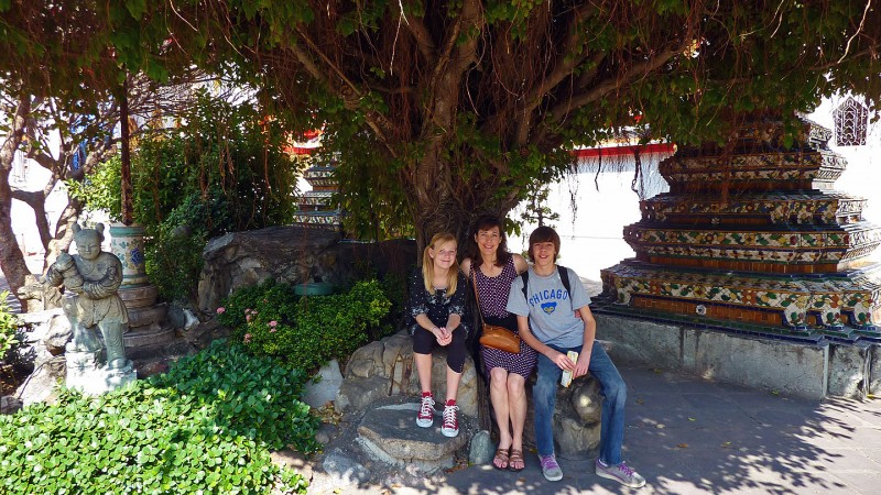 case family at wat po temple pho bangkok thailand