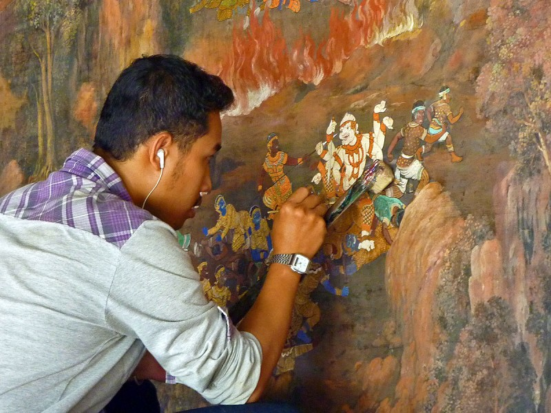 thai person painting at Wat Phra Kaew fresco bangkok