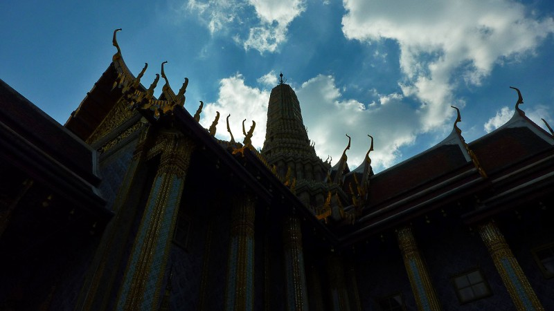 sky contrasted with thai buddhist architecture