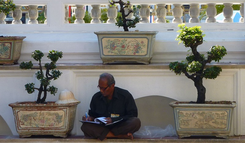 thai man working at grand palace