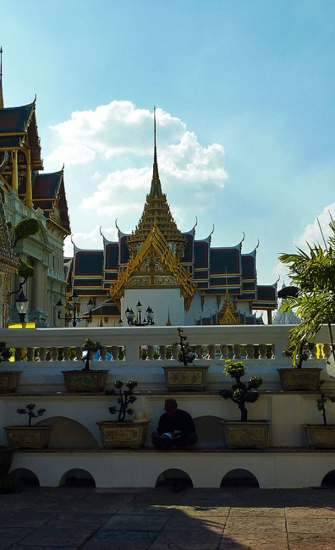 man working in thailand's grand palace
