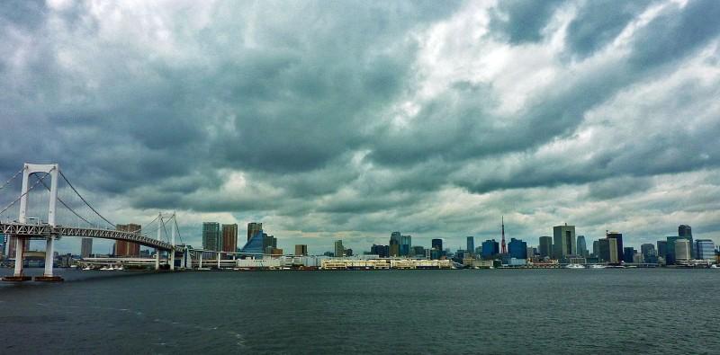 odaiba rainbow bridge tokyo tower dark clouds