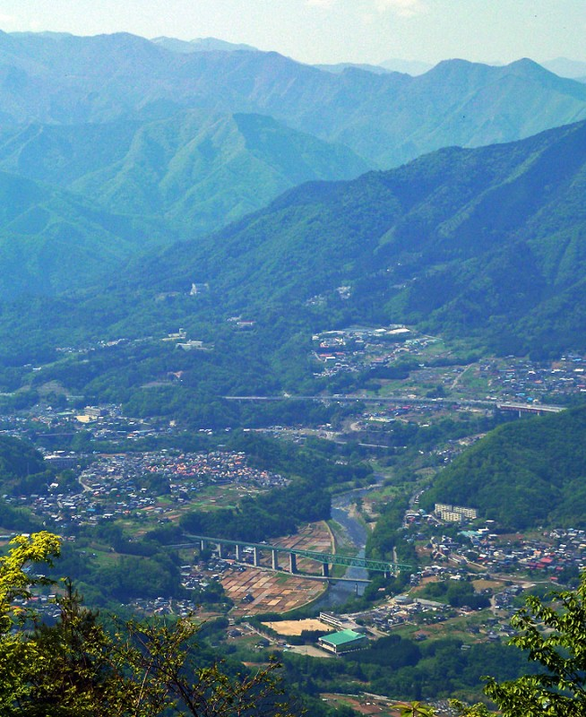 japan town from above bridge train mountains
