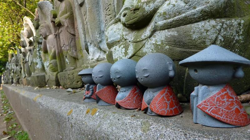 little buddhist statues tokyo japan jizo
