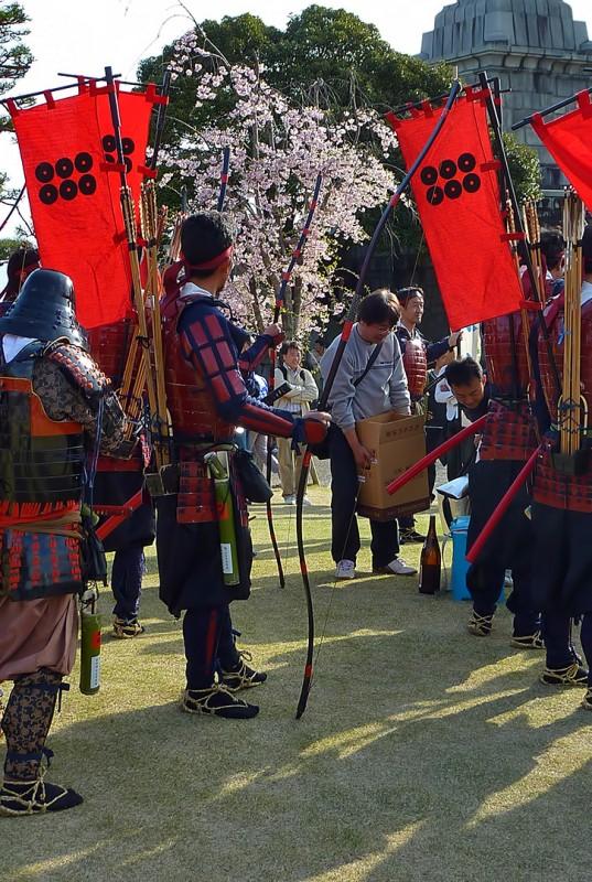 shingenko kofu japan sake drinking bows flags sakura cherry blossoms festival matsuri