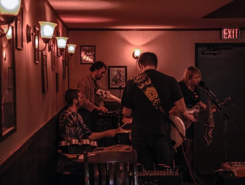 Kimber Parris (Lead Vocals/ Rhythm Guitar), David Bartman (Synth), Dan Freiberg (Drums), and Zack Karr (Bass) twice born gypsies northwest pizza