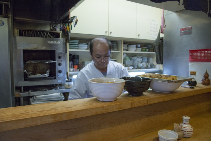 Asano owner, cook, and conversationalist
