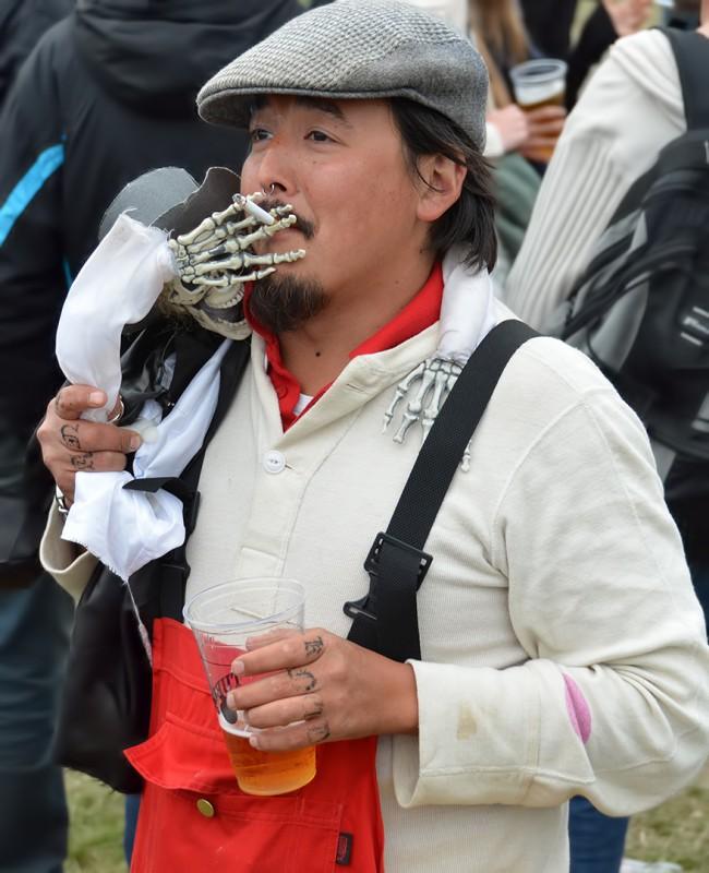 skeleton cigarette holder at roskilde festival costume