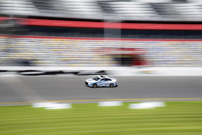 SOU football daytona speedway panning shot of race car