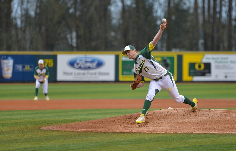 Oregon Ducks Baseball Matt Krook delivers pitch in the rain