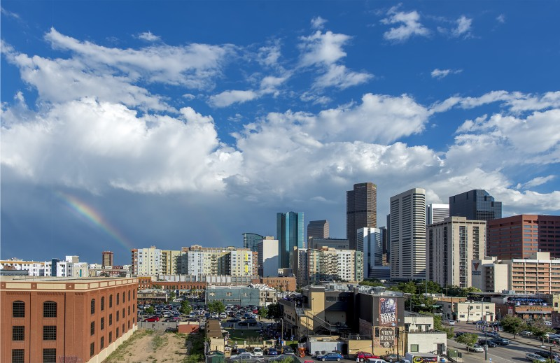 denver skyline from coors field with rainbow