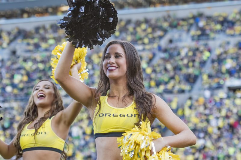 oregon university eugene ducks cheer female pom pom yellow