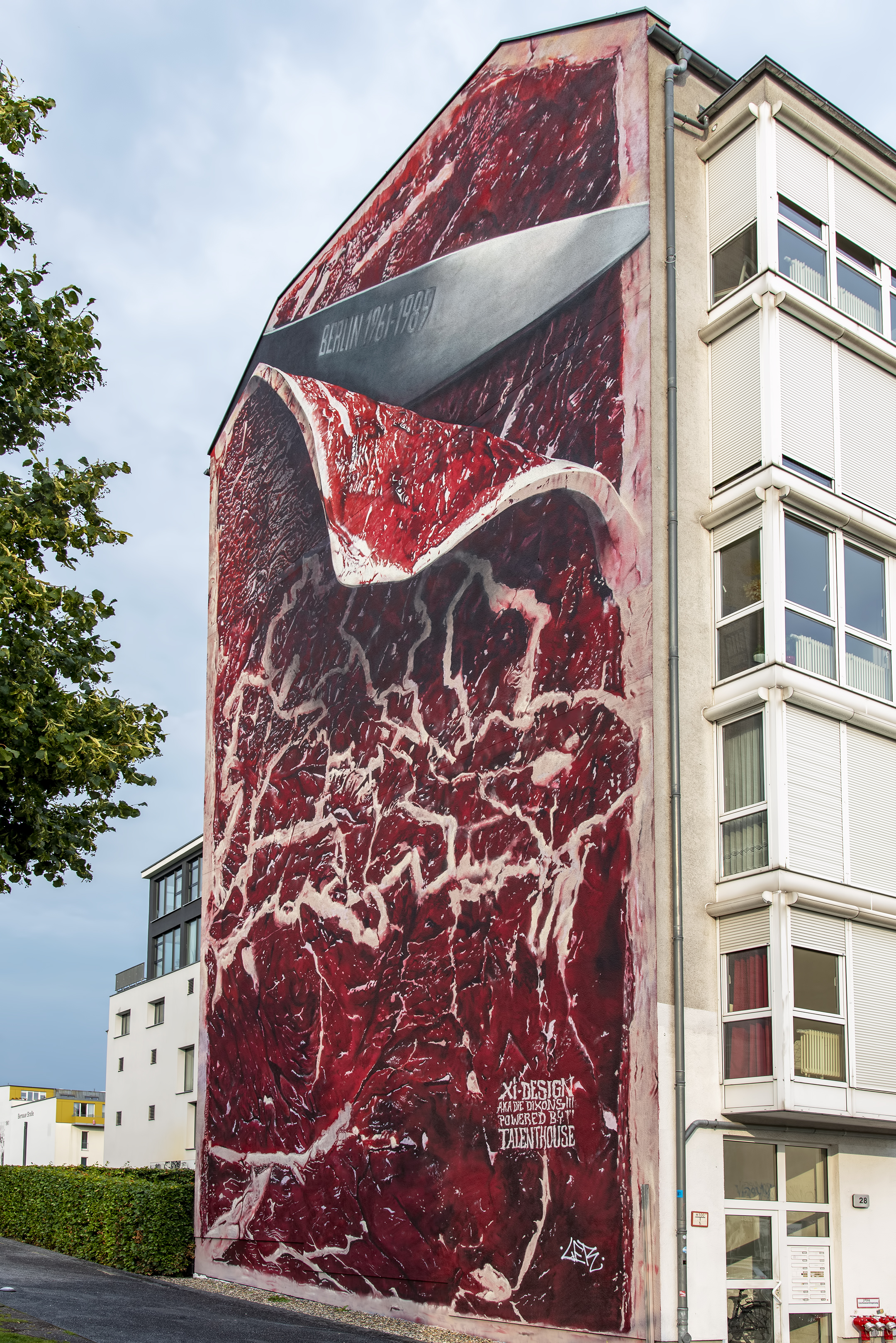 Berlin Wall Memorial Bernauer Street Germany mural meat sliced Artist Marcus Haas Die Dixons graffiti Xi-Design Talenthouse