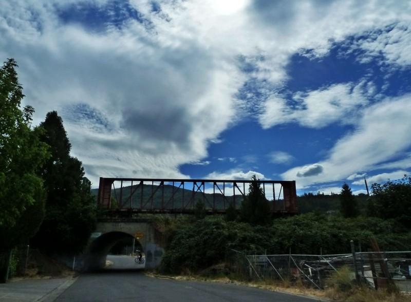 train tracks blue cloudy sky