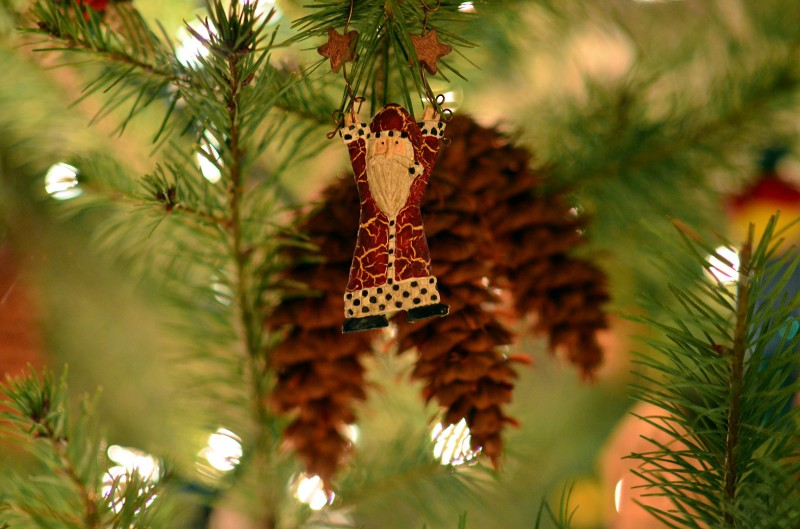 santa claus ornament natural pine cones on christmas tree