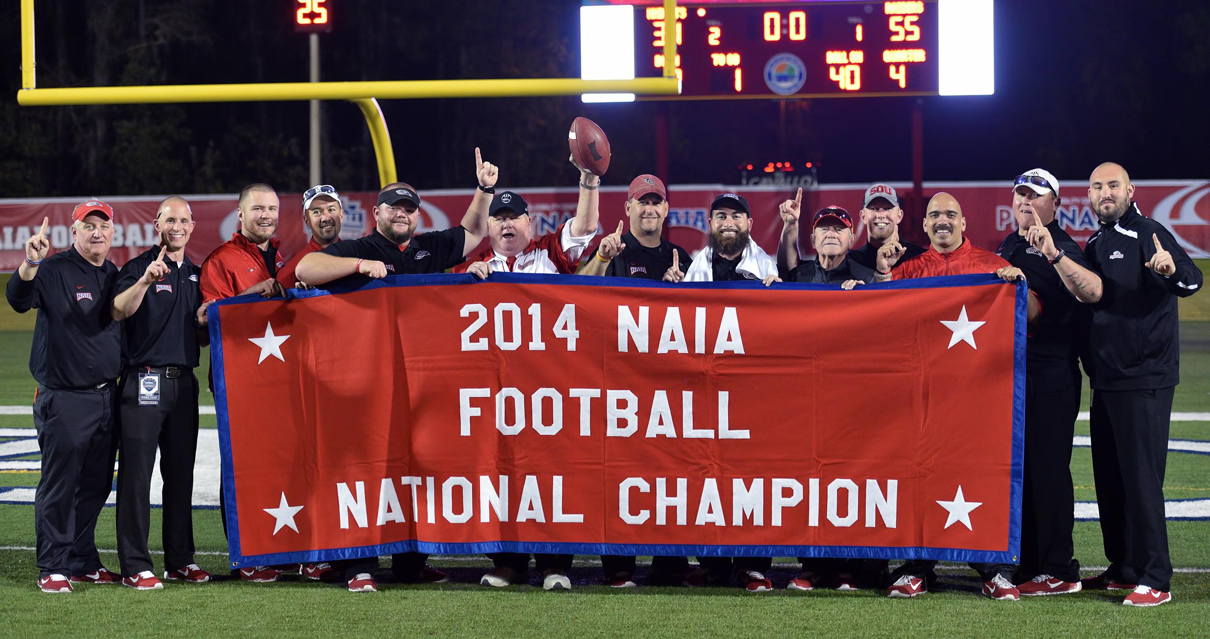 SOU football coaching staff national champion banner 2014 naia