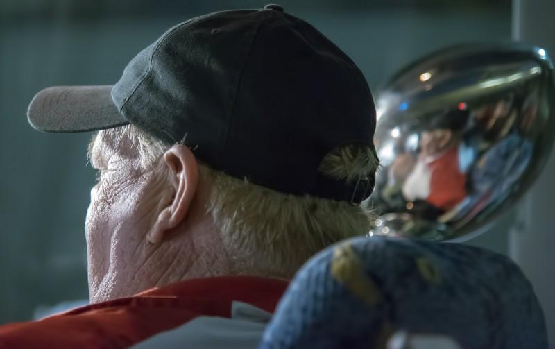 SOU football daytona coach howard riding on bus with trophy