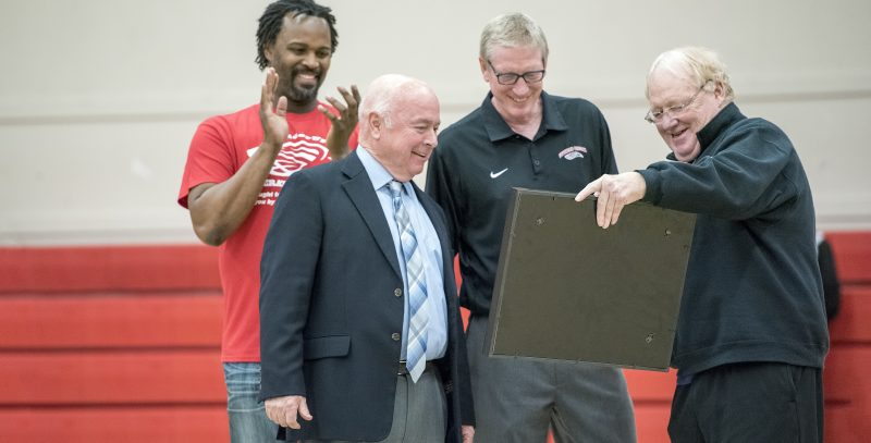 Coach Craig Howard presents Coach Danny Miles with a memento at his final game against his alma mater (February 2016)