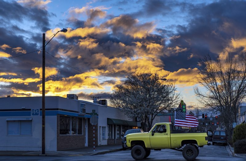 yellow truck american flag grants pass sunset