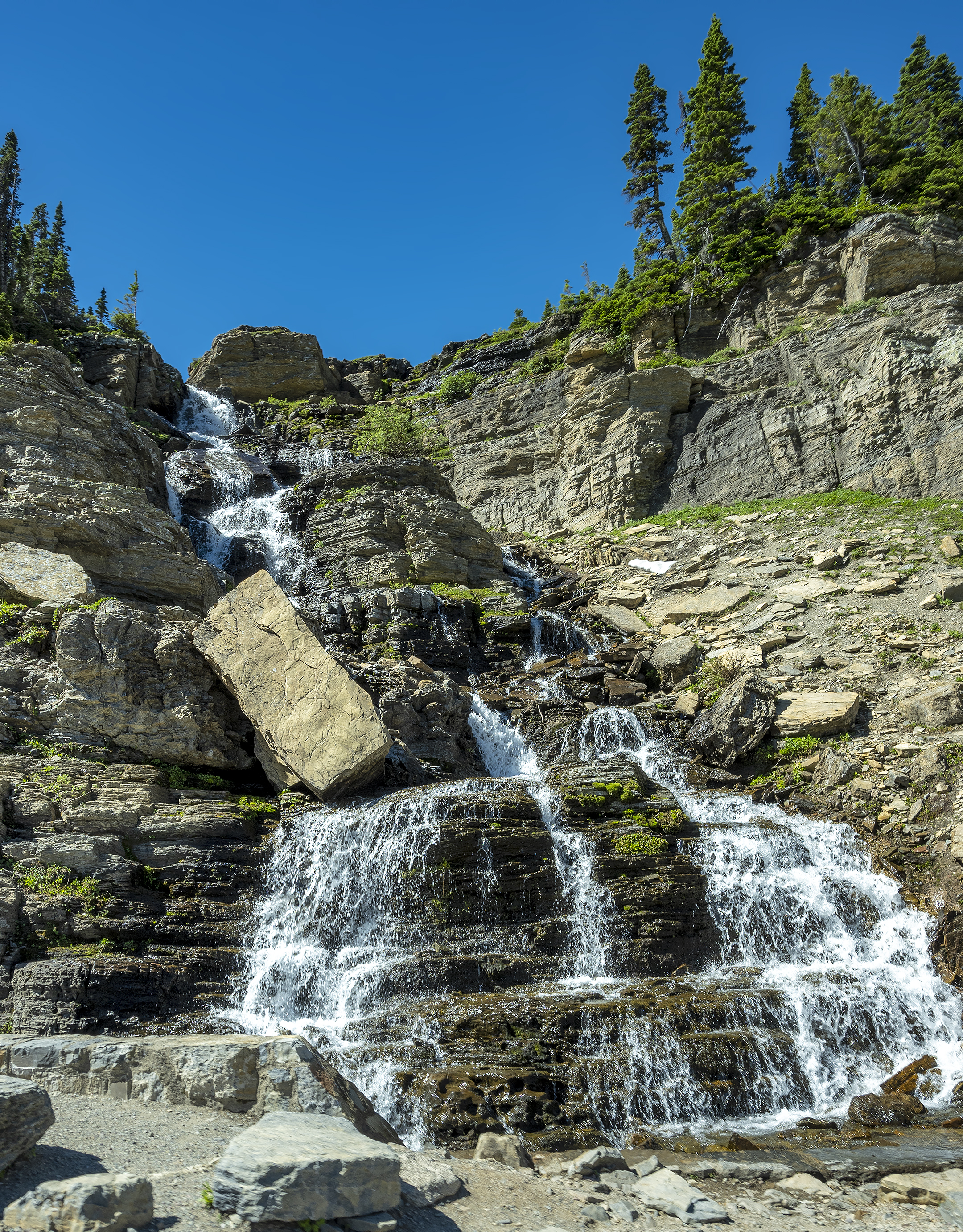 glacier national park waterfall going to the sun road